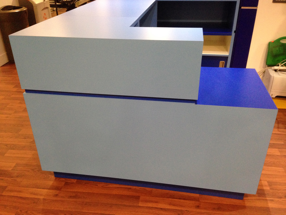 Gym Reception - Preston. Manufactured in 18 mm mr mdf laminated in 2 no colours of formica  laminate