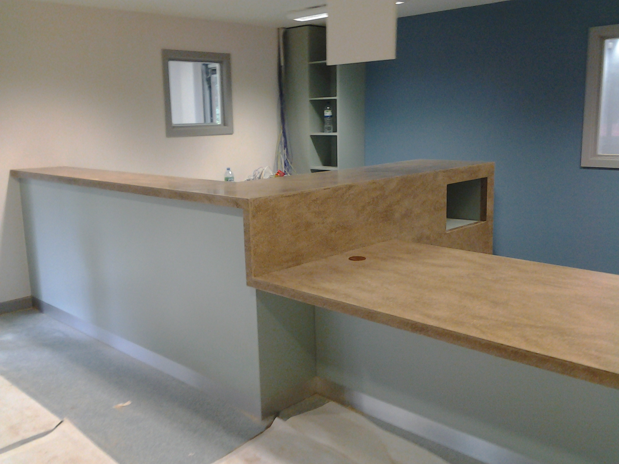 Sports Academy reception counter – Stoke Tops made up from corian. Front from mr mdf laminated in grey formica . Plinth in brushed aluminium abet laminate. All relevant DDA compliant .
