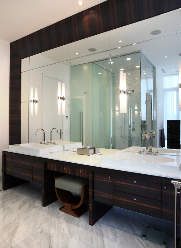 Twin surface mounted sinks, bevelled and etched mirrors with exotic hardwoods