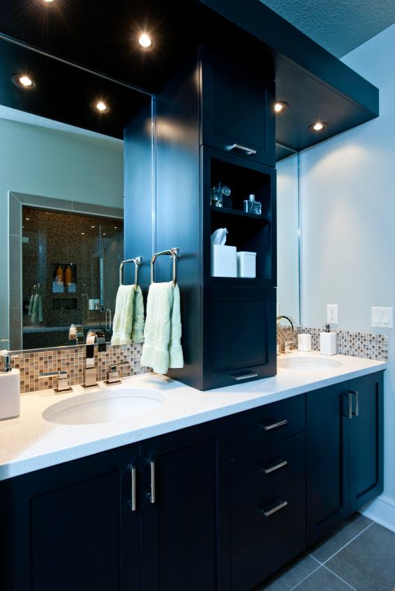 Twin sinks in Corian, cabinets black American walnut.